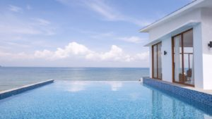 Private pool area boasts sweeping view of the surrounding sea