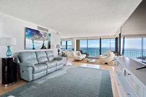 Living area offers breathtaking view of the nearby sea