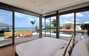 Bedroom opens up to stunning view of the beachfront