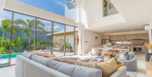 Spacious living area boasts high ceilings and direct access to private pool